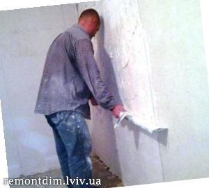 Штукатурка стін (під плитку)